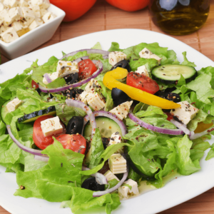 Romaine and iceberg lettuce, red cabbage, tomatoes and black olives with Italian or ranch dressing.