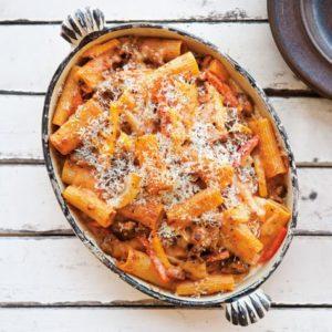 Tube pasta topped with marinara sauce and mozzarella.