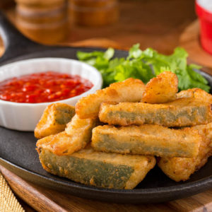 Breaded zucchini sticks served warm.
