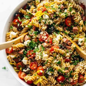 Tri-color rotelli noodles with red roasted peppers, green peppers, tomatoes, feta cheese, Italian spices and Italian dressing.