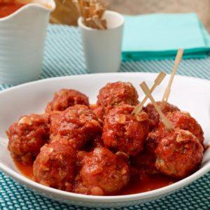 Succulent beef meatballs coated in fresh marinara sauce.